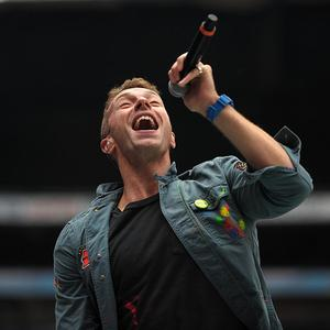 Chris Martin reckons Coldplay aren't good looking enough to be as big as Take That