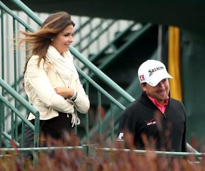 Winning smile: He may have lost but he's still got the girl