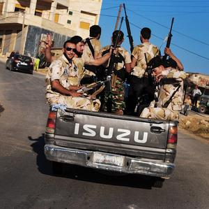 Free Syrian Army soldiers in the northern town of Sarmada, in Idlib province, Syria (AP/Shaam News Network)