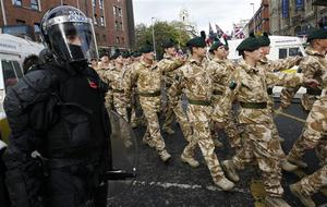 The British Army's Royal Irish Regiment parade through Belfast City under tight security from riot police, Belfast, Northern Ireland, Sunday, Nov. 2, 2008.  Riot police kept apart rival loyalist and Republican supporters at a parade to honor Northern Ireland members of British armed forces that have recently returned from war zones in Iraq and Afghanistan. (AP Photo/Peter Morrison)