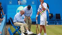 LONDON, ENGLAND - JUNE 17:  David Nalbandian of Argentina (R) looks on as he injures a Line Judge's leg during his mens singles final round match against Marin Cilic of Croatia on day seven of the AEGON Championships at Queens Club on June 17, 2012 in London, England.  (Photo by Clive Brunskill/Getty Images)