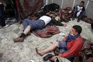 Wounded protesters are seen in a field hospital during clashes with Egyptian riot police in Tahrir Square in Cairo, Egypt, Sunday, Nov. 20, 2011. Firing tear gas and rubber bullets, Egyptian riot police on Sunday clashed for a second day with thousands of rock-throwing protesters demanding that the ruling military quickly announce a date to hand over power to an elected government. (AP Photo)