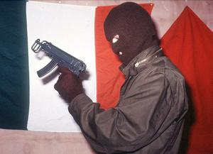 INLA gunmen at a press conference on the Irish Border in 1990.