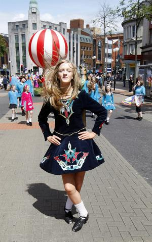Pacemaker Press Intl 18-06-11Irish Dancers preform as the Lord Mayor`s Parade takes to the streets of Belfast. The parade officially introduces the new First Citizen, Councillor Niall Ó Donnghaile, to the people of Belfast.Pic Colm O'Reilly Pacemaker Press Intl