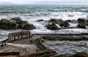 Strong winds batter Ballintoy Harbour