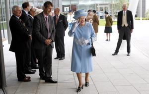 Queen Elizabeth II and the Duke of Edinburgh visit the new South West Acute Hospital in Enniskillen, County Fermanagh, watched by Health Minister Edwin Poots (second left), during a two-day visit to Northern Ireland as part of the Diamond Jubilee tour. PRESS ASSOCIATION Photo. Picture date: Tuesday June 26, 2012. See PA story ROYAL Queen. Photo credit should read: Julien Behal/PA Wire
