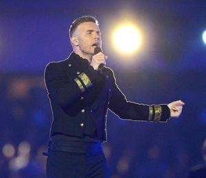 So dignified: Gary Barlow on stage after baby tragedy