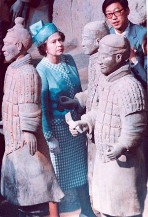 Britain's Queen Elizabeth II walks where few other visitors are allowed, among the famed terracotta warriors in Xian, China, Oct. 16, 1986.  (AP Photo/Peter Bregg)