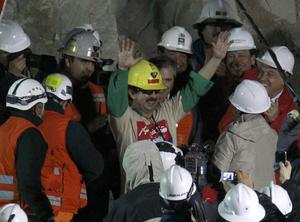 Rescued miner Juan Andres Illanes Palma, third miner to be rescued, salutes at his arrival to the surface from the collapsed San Jose gold and copper mine where he was trapped with 32 other miners for over two months near Copiapo, Chile, Wednesday Oct. 13, 2010.at the San Jose Mine near Copiapo, Chile Wednesday, Oct. 13, 2010.(AP Photo/Roberto Candia)