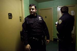 NEW YORK, NY - OCTOBER 28: New York City police officers go door to door in a housing project to take note of which residents are ignoring the mandatory evacuation order as Hurricane Sandy approaches on October 28, 2012 in the Rockaway Beach neighborhood of the Queens borough of New York City. New York City Mayor Michael Bloomberg announced a mandatory evacuation on low-lying coastal areas of the city.  Sandy, which has already claimed over 50 lives in the Caribbean is predicted to bring heavy winds and floodwaters to the mid-Atlantic region. (Photo by Allison Joyce/Getty Images)