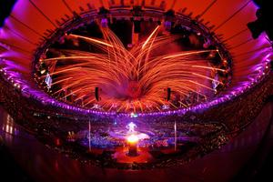 LONDON, ENGLAND - AUGUST 29:  (EDITORS NOTE: THIS IMAGE WAS CREATED WITH A FISH EYE LENS) Fireworks light up the stadium as the Paralympic Cauldron burns during the Opening Ceremony of the London 2012 Paralympics at the Olympic Stadium on August 29, 2012 in London, England.  (Photo by Mike Ehrmann/Getty Images)