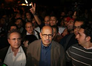CAIRO, EGYPT - JANUARY 30:  Opposition leader Mohamed ElBaradei arrives to speak to supporters in Tahrir Square on January 30, 2011 in Cairo, Egypt. Cairo remained in a state of flux and marchers continued to protest in the streets and defy curfew, demanding the resignation of Egyptian president Hosni Mubarek. As President Mubarak struggles to regain control after five days of protests he has appointed Omar Suleiman as vice-president. The present death toll stands at 100 and up to 2,000 people are thought to have been injured during the clashes which started last Tuesday. Overnight it was reported that thousands of inmates from the Wadi Naturn prison had escaped and that Egyptians were forming vigilante groups in order to protect their homes.   (Photo by Peter Macdiarmid/Getty Images)