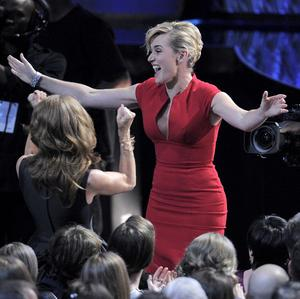 Kate Winslet reacts before going on stage to accept the award for outstanding lead actress in a mini-series or movie for Mildred Pierce (AP)