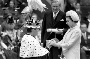 Investiture of Prince of Wales...1969:  Britain's Queen Elizabeth II invests her oldest son as Prince of Wales in a ceremony at Caernarvon Castle.  PA Photo