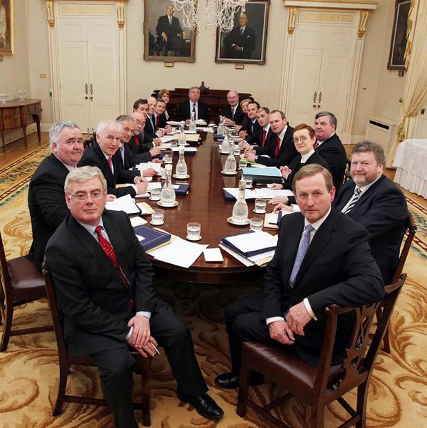 The new Taoiseach Enda Kenny (front right) with his new top table during the first Cabinet meeting