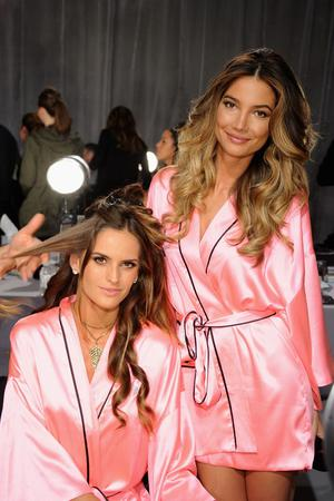 NEW YORK, NY - NOVEMBER 07:  Victoria's Secret Angels Alessandra Ambrosio and Lily Aldridge prepare backstage at the 2012 Victoria's Secret Fashion Show at the Lexington Avenue Armory on November 7, 2012 in New York City.  (Photo by Jamie McCarthy/Getty Images)
