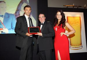 Northern Ireland international and Ipswich Town player Gareth McAuley was awarded the Carling International Personality of the Year award. Presenting the award to Gareth is Carling's Niall McMullan with  Carling girl Melissa Patton