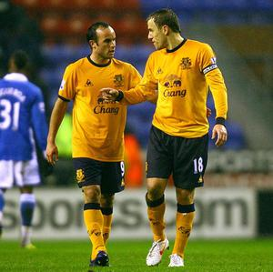 Phil Neville (right) believes Landon Donovan is a hero at Goodison Park