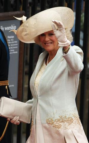 LONDON, ENGLAND - APRIL 29:  Camilla, Duchess of Cornwall arrives to attend the Royal Wedding of Prince William to Catherine Middleton at Westminster Abbey on April 29, 2011 in London, England. The marriage of the second in line to the British throne is to be led by the Archbishop of Canterbury and will be attended by 1900 guests, including foreign Royal family members and heads of state. Thousands of well-wishers from around the world have also flocked to London to witness the spectacle and pageantry of the Royal Wedding.  (Photo by Dan Kitwood/Getty Images)