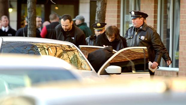 HOBOKEN, NJ - DECEMBER 14:  A man is escorted to a car by law enforcement in connection with an elementary school shooting on December 14, 2012 in Hoboken, New Jersey. According to reports, there are 27 dead, including 20 children, after a gunman identified as Adam Lanza, opened fire in at the Sandy Hook Elementary School in Newtown, Connecticut. The shooter, identified as Adam Lanza was also found dead at the scene.  (Photo by Michael Bocchieri/Getty Images)