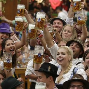 Young people enjoy the opening ceremony of the famous Bavarian Oktoberfest beer festival in Munich, southern Germany (AP)