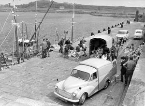 Children helping fishermen to unload cargo at the quayside at Ardglass to-day. 11/6/1966