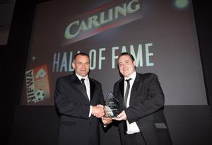 Glenn Ferguson is presented with his Hall of Fame award by Mark McIntosh