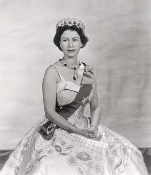 The official portrait of Britain's Queen Elizabeth by Baron in 1957. The Queen wears a crinoline-style gown by Norman Hartnell with the Vladimir Tiara and the Cambridge Emerald Necklace.