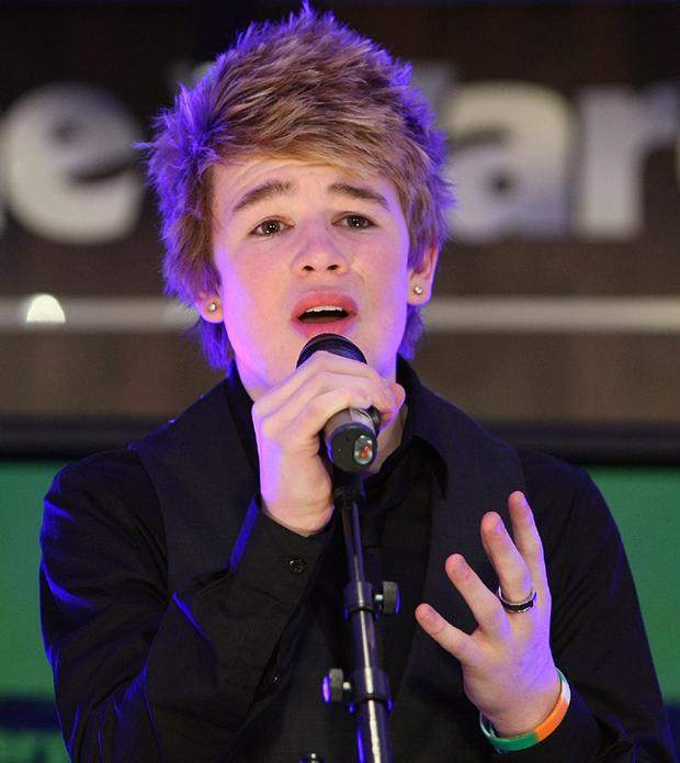 Eoghan Quigg performs at a private X Factor gig in London