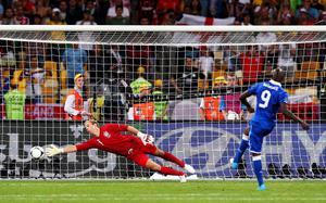 KIEV, UKRAINE - JUNE 24: Mario Balotelli of Italy scores his penalty past Joe Hart of England during the shoot out during the UEFA EURO 2012 quarter final match between England and Italy at The Olympic Stadium on June 24, 2012 in Kiev, Ukraine.  (Photo by Alex Livesey/Getty Images)