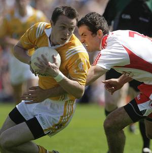 Justin McMahon (right) will return to bolster Tyrone's side