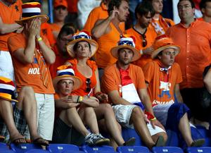 KHARKOV, UKRAINE - JUNE 13:  Netherlands fans look dejected after the UEFA EURO 2012 group B match between Netherlands and Germany at Metalist Stadium on June 13, 2012 in Kharkov, Ukraine.  (Photo by Julian Finney/Getty Images)
