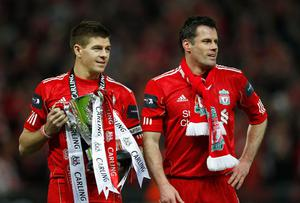 LONDON, ENGLAND - FEBRUARY 26:  Steven Gerrard and Jamie Carragher of Liverpool celebrate with the trophy after victory in the Carling Cup Final match between Liverpool and Cardiff City at Wembley Stadium on February 26, 2012 in London, England. Liverpool won 3-2 on penalties.  (Photo by Paul Gilham/Getty Images)