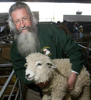 12.05.10.  The first day of the Balmoral Show which took place in the Kings Hall, Belfast. Thomas Cole holding a rare Leicster Long Wool lamb