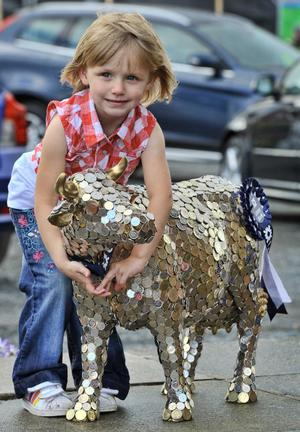 2th May 2010.  Balmoral Show at The Kings Hall, Belfast. 4 Year Old Chloe McKibbin from Coleraine with the Ulser Bank cash cow