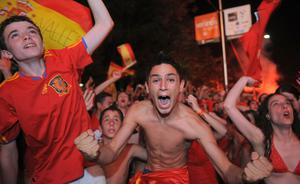 Spaniards celebrate in Madrid while watching on an outdoor tv screen Spain play The Netherlands in the FIFA World Cup Final on July 11, 2010 in Madrid, Spain