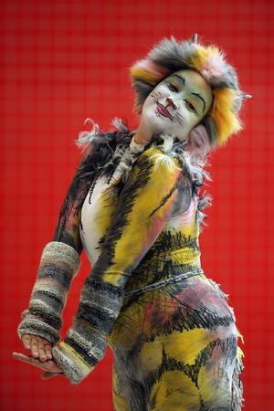 LONDON, ENGLAND - OCTOBER 26: Jess Hodges 29, from Robertsbridge poses as a character from the musical 'Cats' ahead of the MCM London Comic Con Expo at ExCel on October 26, 2012 in London, England. Visitors to the Comic Convention are encouraged to wear a costume of their favourite comic character and flock to the Expo to gather all the latest news in the world of comics, manga, anime, film, cosplay, games and cult fiction.  (Photo by Dan Kitwood/Getty Images)