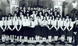 The full choir, pictured with their trophy, during a visit to Belfast City Hall, 1986.