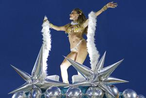 A dancer performs on the top of a float during the parade of Gavioes da Fiel samba school in Sao Paulo, Brazil, Sunday March 6, 2011. (AP Photo/Andre Penner)