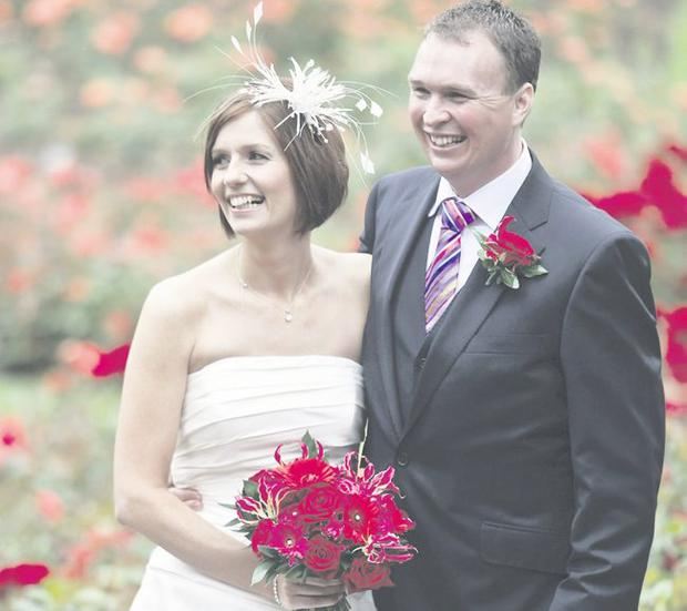 """Big day: Brett and Lydia McClelland smile for the camera in Sir Thomas and Lady Dixon Park <p><b>To send us your Wedding Pics <a  href=""""http://www.belfasttelegraph.co.uk/usersubmission/the-belfast-telegraph-wants-to-hear-from-you-13927437.html"""" title=""""Click here to send your pics to Belfast Telegraph"""">Click here</a> </a></p></b>"""