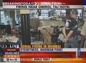 "Police officers at the scene of a restaurant attack in Mumbai, India in this image made from television, Wednesday, Nov. 26, 2008. Gunmen targeted luxury hotels, a popular tourist attraction and a crowded train station in at least seven attacks in India's financial capital Wednesday, wounding 25 people, police and witnesses said. A.N Roy police commissioner of Maharashtra state, of which Mumbai is the capital, said several people had been wounded in the attacks and police were battling the gunmen. ""The terrorists have used automatic weapons and in some places grenades have been lobbed,"" said Roy. Gunmen opened fire on two of the city's best known Luxury hotels, the Taj Mahal and the Oberoi. They also attacked the crowded Chhatrapati Shivaji Terminus station in southern Mumbai and Leopold's restaurant, a Mumbai landmark. It was not immediately clear what the motive was for the attacks.  (AP Photo/NDTV)  **  INDIA OUT  TV OUT  **"