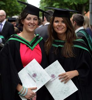 29.06.11. PICTURE BY DAVID FITZGERALDUniversity of Ulster Graduations at the Waterfront Hall, Belfast yesterday. Ruth Kirkpatrick and Katie Jones who studied Property Investment and Development