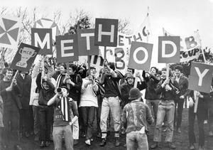 Methody supporters in gay mood make a colourful spectacle with their banners and placards as they watch the Schools' Cup match with Annadale, at Pirrie Park, 1970.