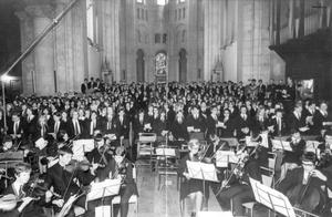 Methodist College choirs and orchestras fill St. Anne's Cathedral, Belfast, for their performance of a cantata specially written by Raymond Warren for the college's centenary celebrations. Pupils of both the senior and junior schools took part, 1968.