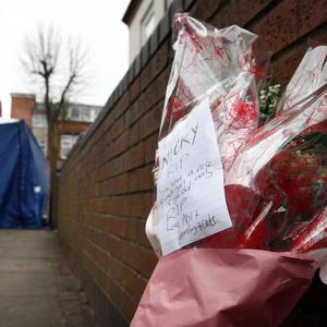 A floral tribute is placed against a wall outside a house in Whateley Road, Handsworth, after a body was found