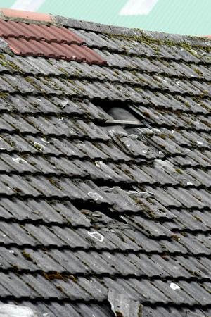 Holes in the roof where tiles are missing