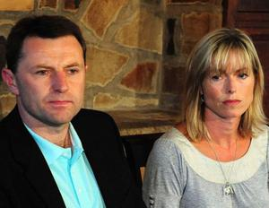Kate and Gerry McCann as they give a statement at the Rothley Court Hotel, in Rothley, Leicestershire after they were formally cleared by the Portuguese authorities of involvement in their daughter Madeleine's disappearance .