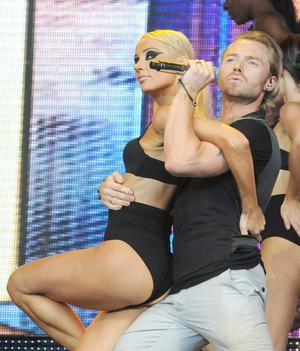 Ronan Keating performing with dancers on stage