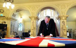 A mock signing of the Ulster Covenant took place before the Commemorations at City Hall