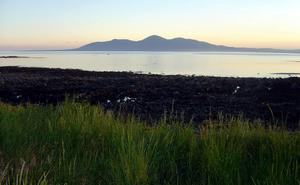Mournes at dusk. The Mourne Mountains from St John's Point. 2012. Submitted by Kelvin